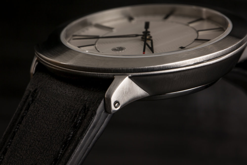 DetailS - Due to the dateless design, the crown stem is modified so that there is only one position. For a smooth feel, the crown is precisely measured to integrate seamlessly with the crown guards. The polished rehaut reflects the applied indices, which are painted on the top and polished on the sides to preserve legibility while maintaining a subtle sparkle. The skeletonized hands are color matched to the indices. These are just a few examples of how the fit, feel, and finish are rounded out on the Spiral.