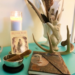 This sacred space was created specifically for journeying. A   singing bowl  , an   oracle card  , a special journal, and other items set the stage without being too much.