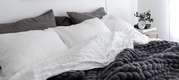 Scandinavian-style-bedroom-with-linen-bedding-Ohhio-chunky-merino-wool-blanket-and-Rainy-Day-print-by-Anu-Tammiste-1.jpg