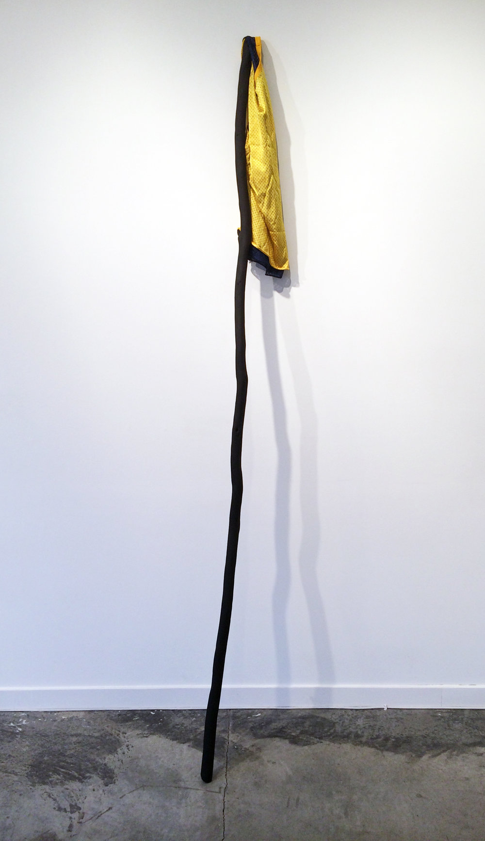 "JOSEPH HART   Untitled , athletic jersey, acrylic and found tree branch, 90"" x 14"" x 16"", 2014"