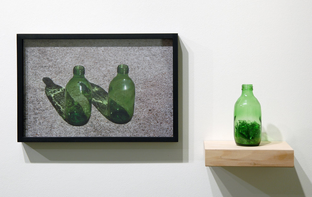 "WITH CINDER BLOCKS WE FLATTEN OUR PHOTOGRAPHS  Pablo Guardiola,  Untitled , c-print, glass bottle, broken glass and shelf, 26"" x 12.5"" x 6"", 2013"