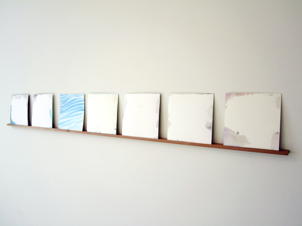 "MOLLY SMITH   Forecast,  2013, ink on paper and cedar (7 pieces), 10"" x 10"" each (shelf 86"" x 1.25"")"