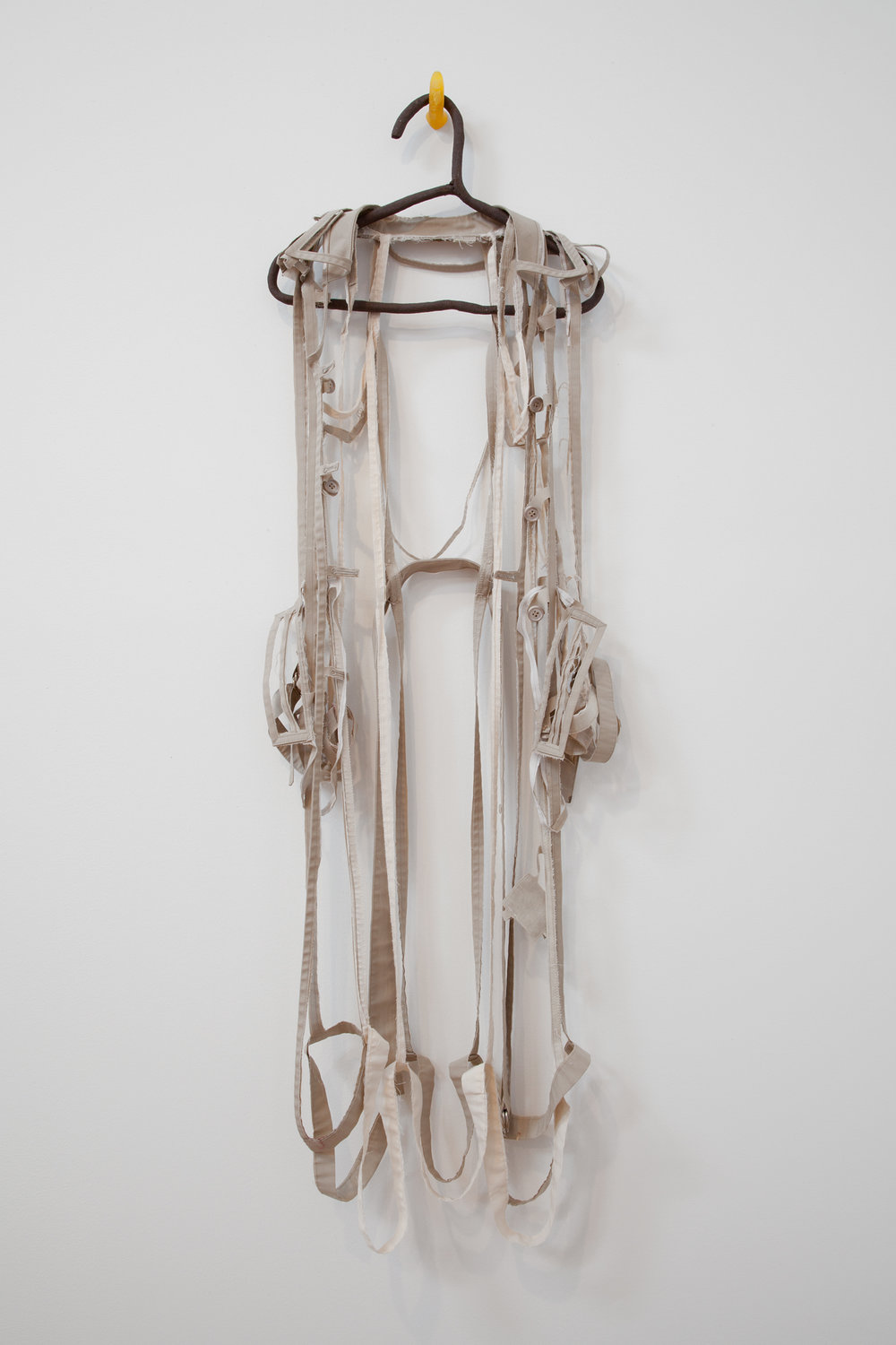 "ANNA SEW HOY   beige/cream , fired stoneware, trench coat and resin finger hook, 55"" x 17"" x 3.5"", 2012"