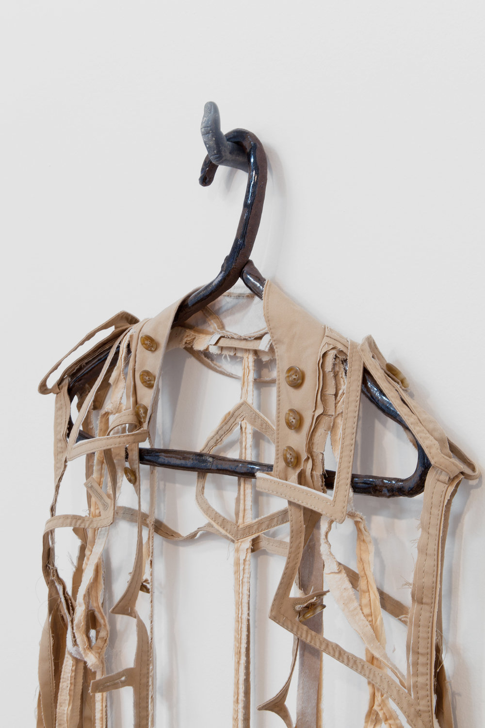"ANNA SEW HOY  (detail)  beige/tan , fired stoneware, trench coat and resin finger hook, 62.5"" x 17"" x 4"", 2012"