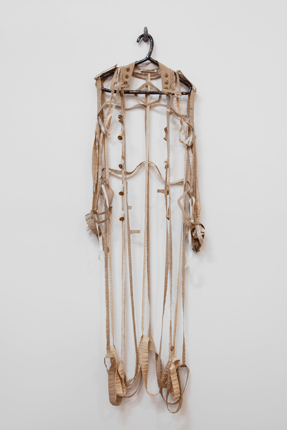"ANNA SEW HOY   beige/tan , fired stoneware, trench coat and resin finger hook, 62.5"" x 17"" x 4"", 2012"