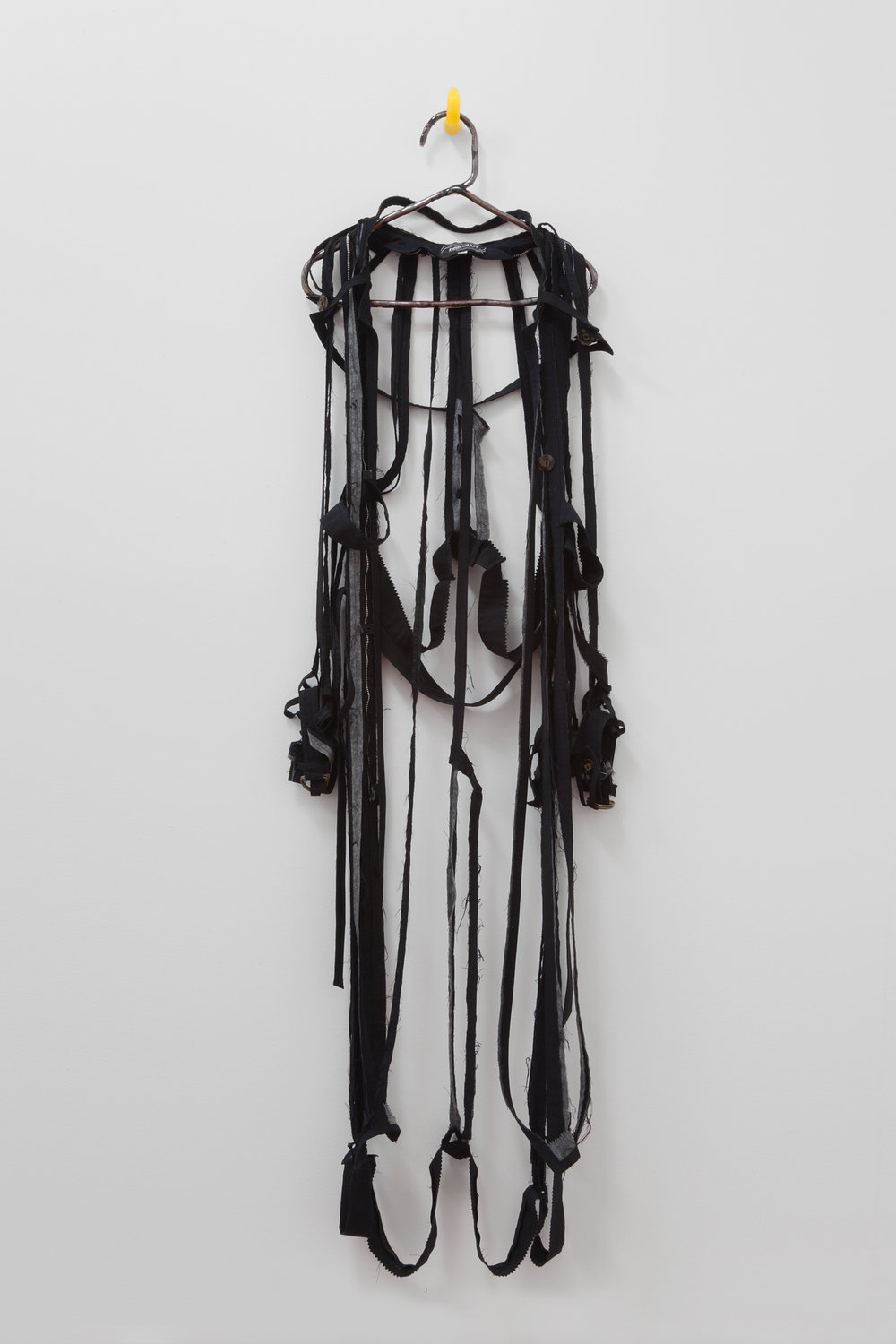 "ANNA SEW HOY   black/noire , fired stoneware, trench coat and resin finger hook, 62.5"" x 16.5"" x 4"", 2012"