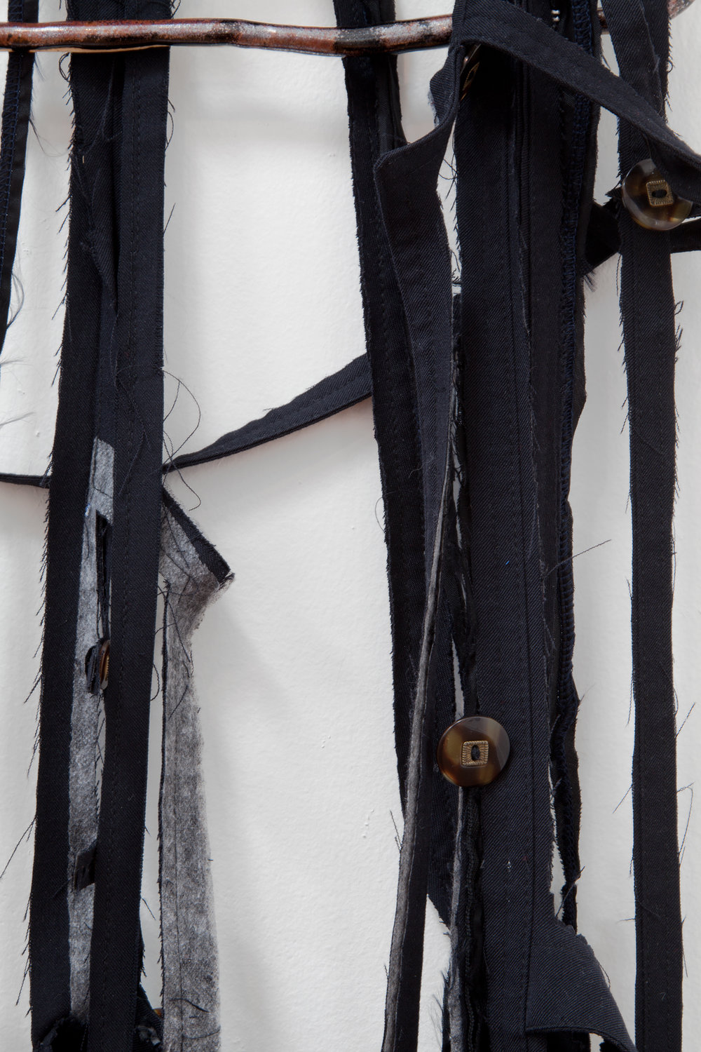 "ANNA SEW HOY  (detail)  black/noire , fired stoneware, trench coat and resin finger hook, 62.5"" x 16.5"" x 4"", 2012"