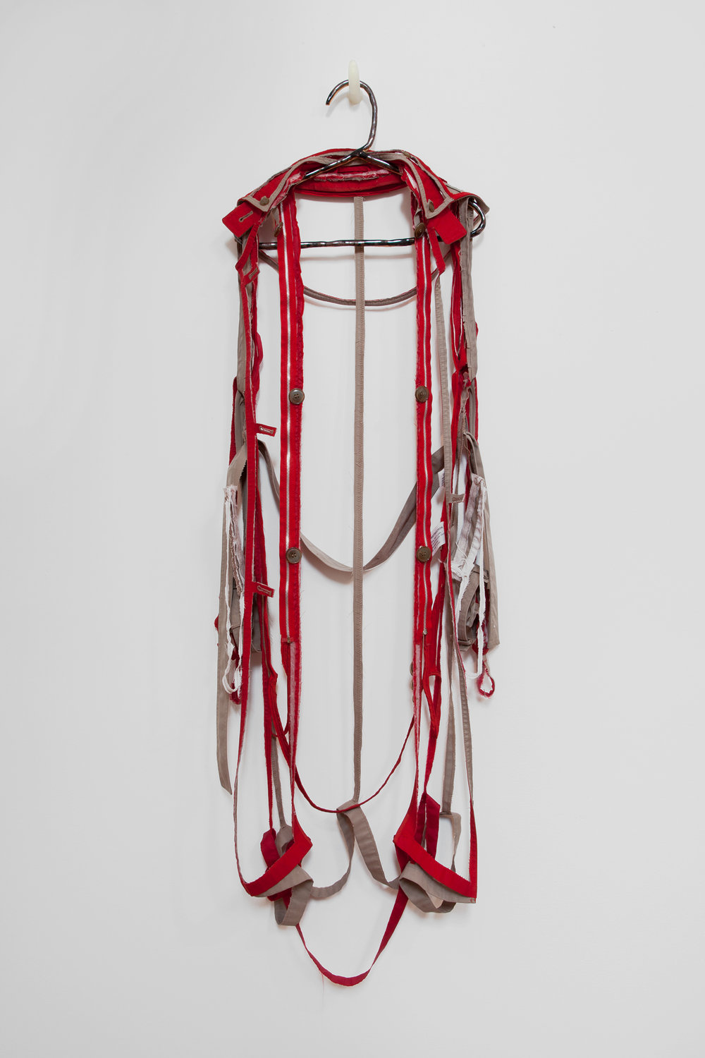 "ANNA SEW HOY   rouge/tan , fired stoneware, trench coat and resin finger hook, 58"" x 17"" x 5"", 2012"