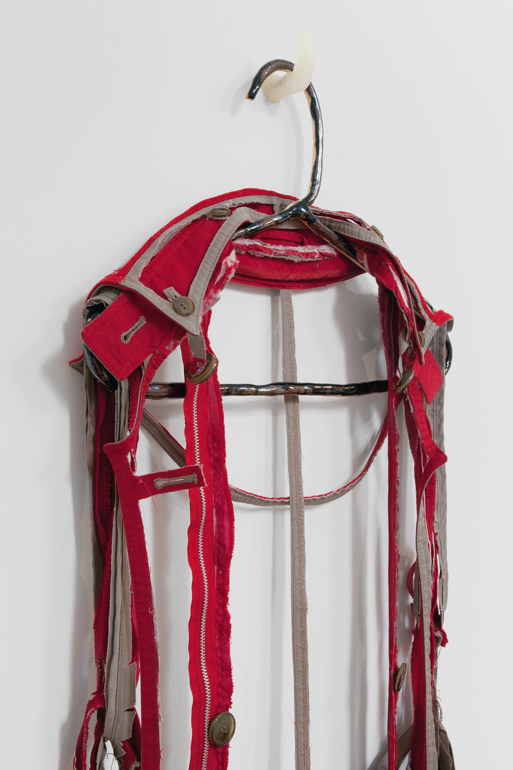 "ANNA SEW HOY  (detail)  rouge/tan , fired stoneware, trench coat and resin finger hook, 58"" x 17"" x 5"", 2012"