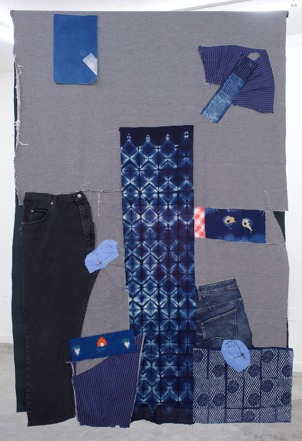 "AMANDA CURRERI Homo-Hime, 2018 Hand-dyed and hand-printed fabrics with indigo, madder, soot/soya, acrylic on various fabrics such as used tablecloths, vintage Japanese silk, Japanese denim (new), deconstructed denim jeans, dog toy eyes, digital print on fabric (two-sided), 72"" x 48"""