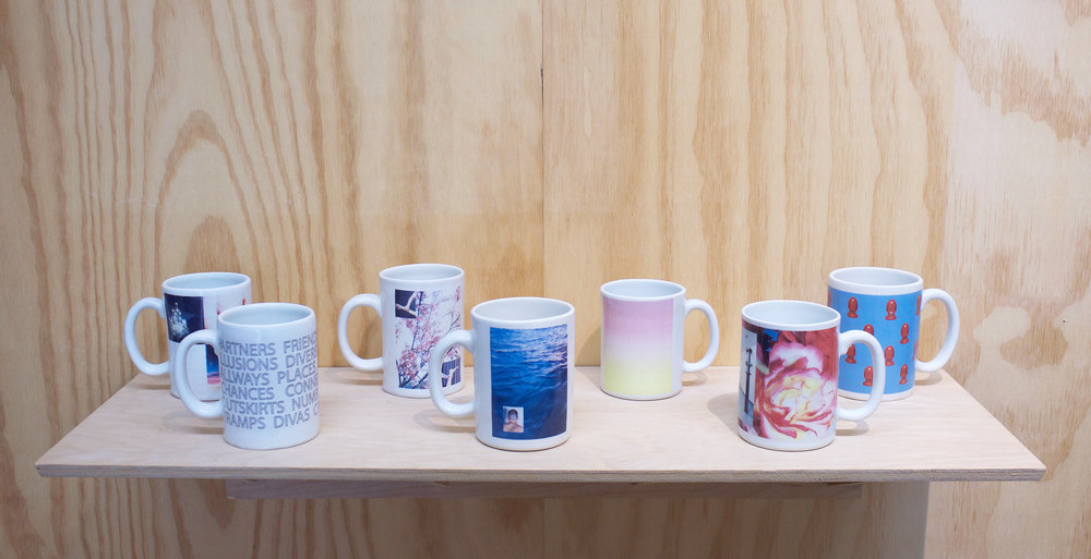 "Erik Scollon Shelf #1, 2018 7 individual handmade porcelain mugs with artist made ceramic decals, glaze and wooden shelf, 6"" x 32"" x 11"""