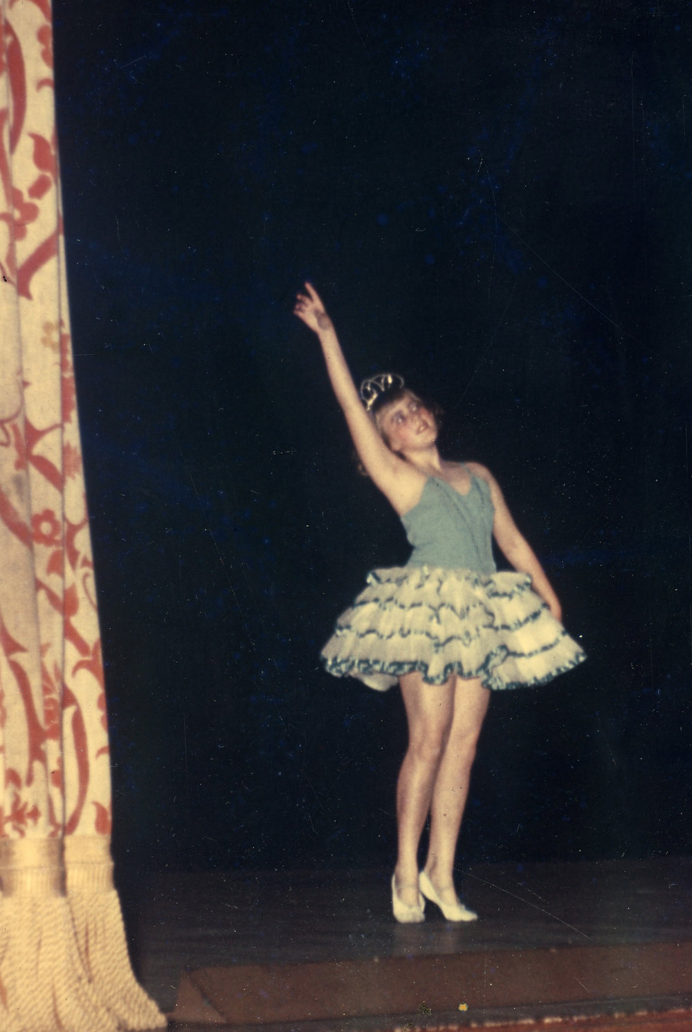 My favorite ballet costume -- rows of ruffles edged with satin ribbon and a sparkly tiara.  I felt like a princess!