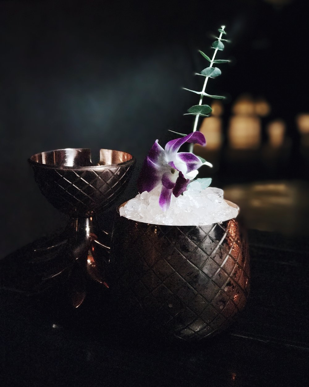 The Seana cocktail with features passion fruit and is served in a pineapple goblet.
