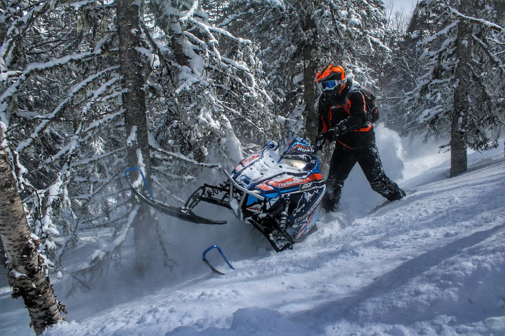 """Ryan Verrecchia Location: Quebec Canada   Hey everyone i'm 22 years old; as most sledders do I started off young at the age of 6 getting into snowmobiling. By the time I was 8 I was riding an old 800 144 summit. I only started to ride backcountry when my dad bought the first 2012 PRO RMK chassis. Which then became my sled to learn and practice on and now I'm currently going to be riding a 17 axys 155 and also a 18 axys 155. During the winter i run a backcountry snowmobiling clinic """"The Sled Den"""" with my dad. I ride all winter long with clients/friends having fun and pushing the limits! When I'm not guiding in the winter I'm doing road construction all summer long so I can play all winter long and buy parts haha. """"Trust me and just pin it"""""""