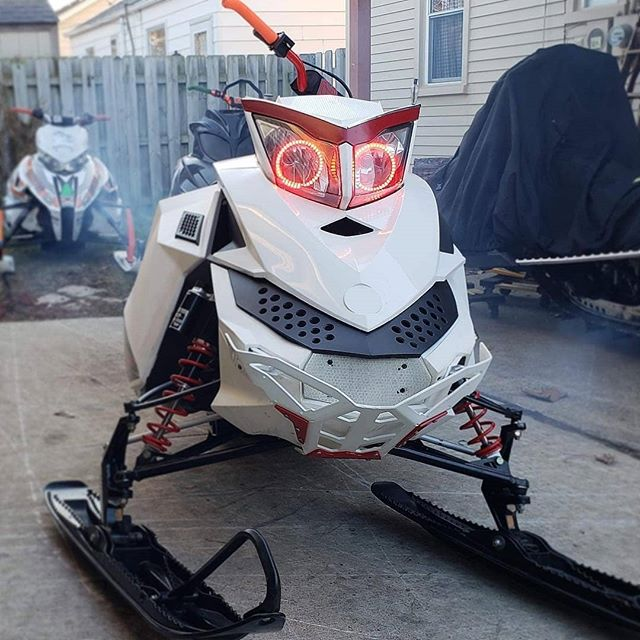 "Check out family rider :@b2brownie423  New build! This sled is 🔥! Head on over to his page to see some more! ""Well I didn't get my wish for snow but I'm still excited to show off the rebuild! Lots of love thrown at this sled in the past few months. Can't wait to rip it!! Thanks again to many companies and friends for the help! @sledders_r_us  @sledmichigan  @cheetah_racks  @motoseat  @provendesignproducts  @composit_tracks  @cobrapullcords  @wahlbrosracing  @racewerx  @bradt509  @dirtydustyd  @neck_mcd  Freshly rebuilt top end pushing a 2.6 inch track on 7 tooth drivers while screaming out of the tunnel dump! All new bearings in the skid along with carbides and skis. Seat shaved down about a inch and narrowed a touch before being wrapped with the moto seat. Rage cage reeds to express the rebuilt carbs thoughts. Braced the front end and added a little protection thanks to the race werx bumper.  Only thing I didn't get done before the reveal was change out the front black plastic piece for the one I had wrapped. Just gotta pick it up from a buddy. I'm not against wraps. I think most look pretty cool! But I personally like the plain clean look. #sleddersrus #sledmichigan #cheetahracks #cfr #longtrack #luglife #slednecks #braap #braaplife #sendit #builtnotbought #rebuild #skidoo #summit #skidoosummit """