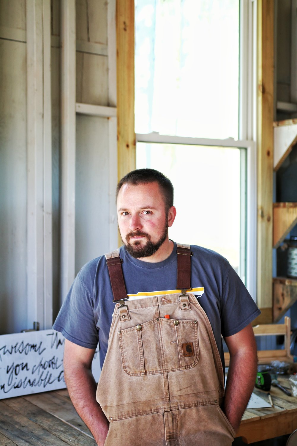 Peter serves as Milk Moon House's carpenter and  specializes in custom shelving, barn doors, and any other project our clients dream up or grab off Pinterest or find in a catalog. He's also the founder and sole employee of the MMH delivery company. He's the handsome fella at your doorstep with a smile and great handshake.