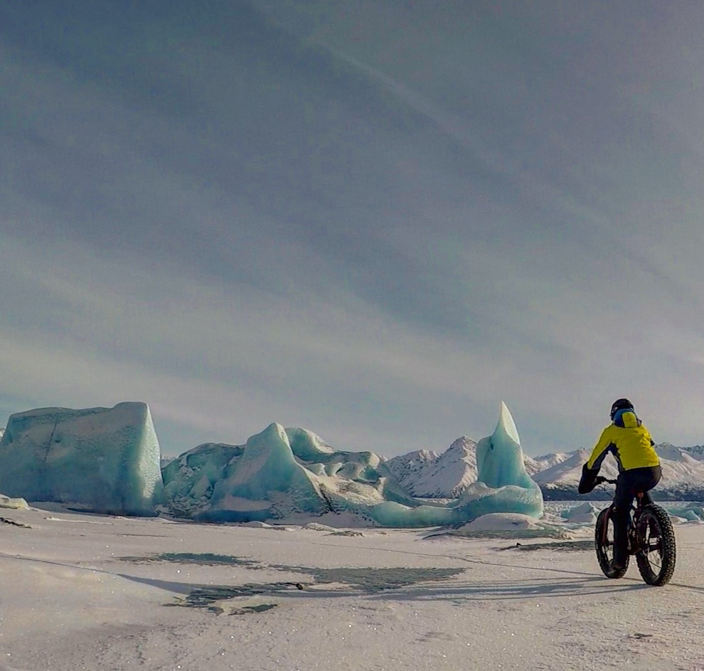 fat tire biking on frozen Knik Lake around icebergs at Knik Glacier