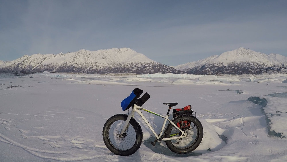 Fat tire bike in front of mountains and glaciers in winter