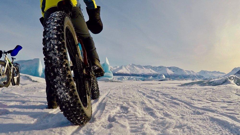 View of Knik Glacier on frozen lake in winter
