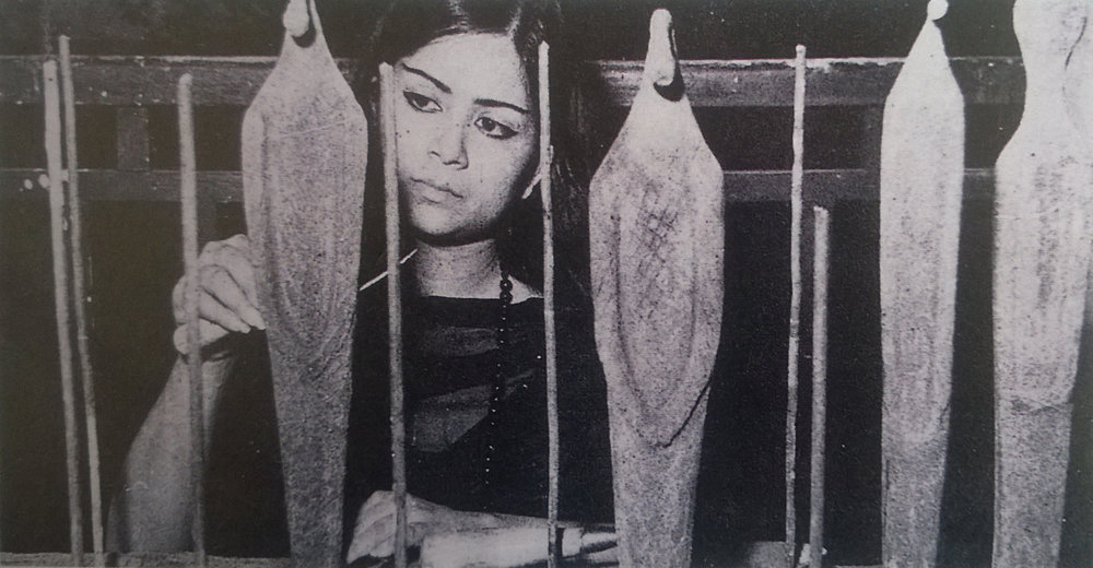 Image of Novera Ahmed, with her work  Give Us This Day . Courtesy of Salima Hashmi.