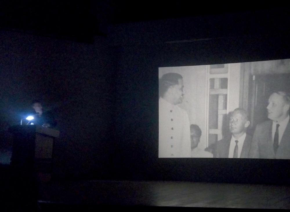 Matti Braun presenting his illustrated lecture, 'Vikram Sarabhai'