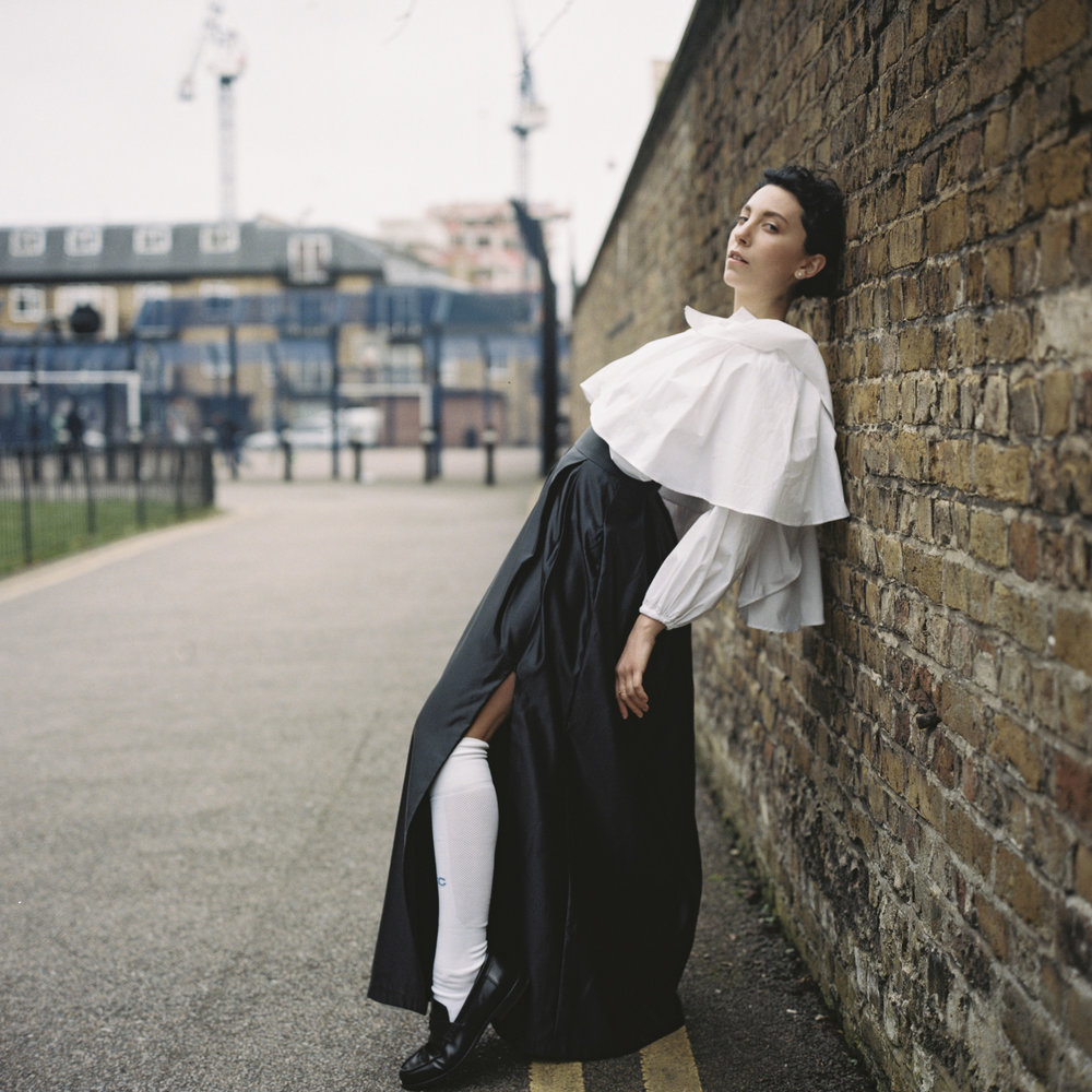 Lily Cape Blouse  >     Enquire    Pearl Pleated Skirt  >     Enquire