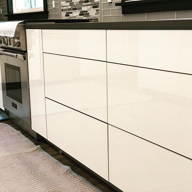 Kitchen progress picture from this high gloss project. Love the way the light bounces off this material! @trademark_custom_builders @cross_and_lincoln #customhomebuilder #homebuilder #builder #remodel #renovation #kitchenremodel #customcabinets #cabinets #kitchencabinets #moderncabinets #kitchendesign #cabinetdesign #thermadorappliances #thermador @thermadorhome