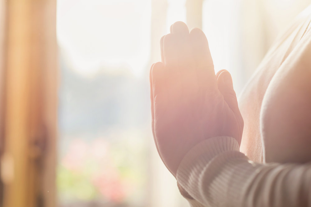 graphicstock-hands-of-an-unrecognizable-woman-standing-by-the-window-and-praying_HAT8PQaZb.jpg