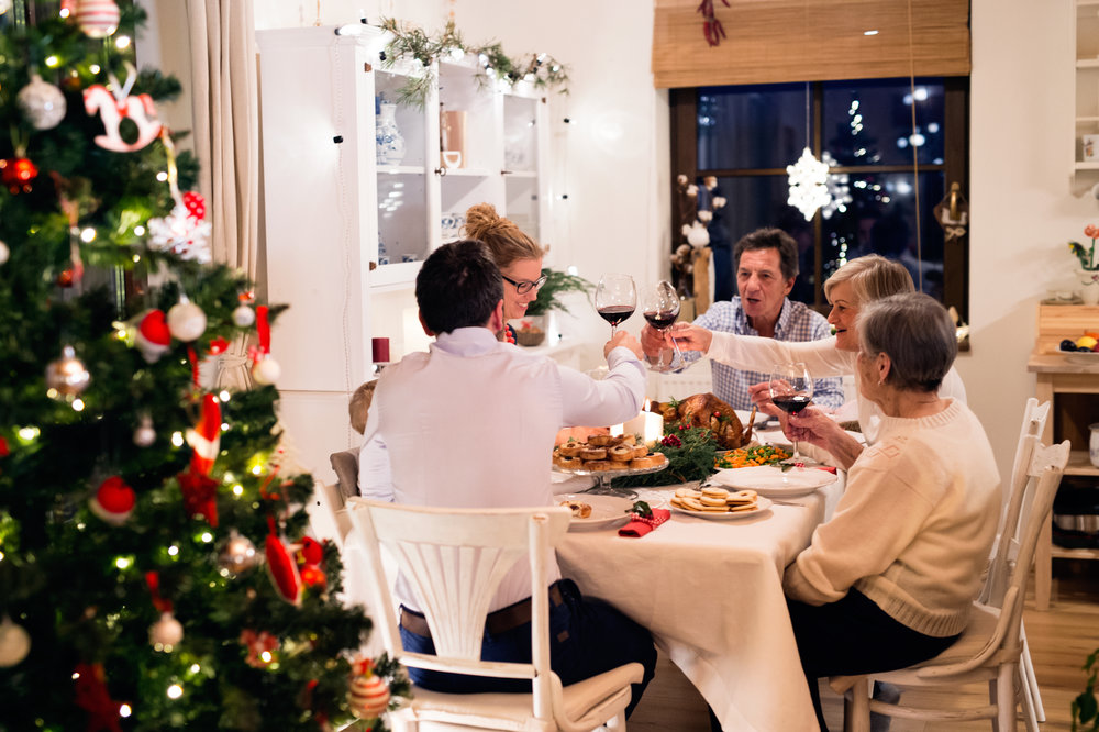 graphicstock-beautiful-big-family-sitting-at-the-table-celebrating-christmas-together-at-home-illuminated-christmas-tree-behind-them_Bd-5Ca3rMW.jpg