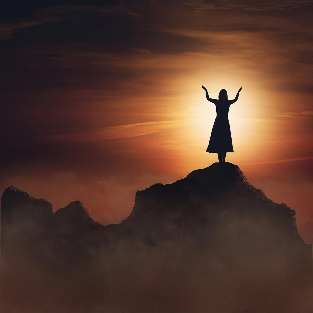 woman-on-mountain-in-praise-and-worship_BXmzp0-xC.jpg