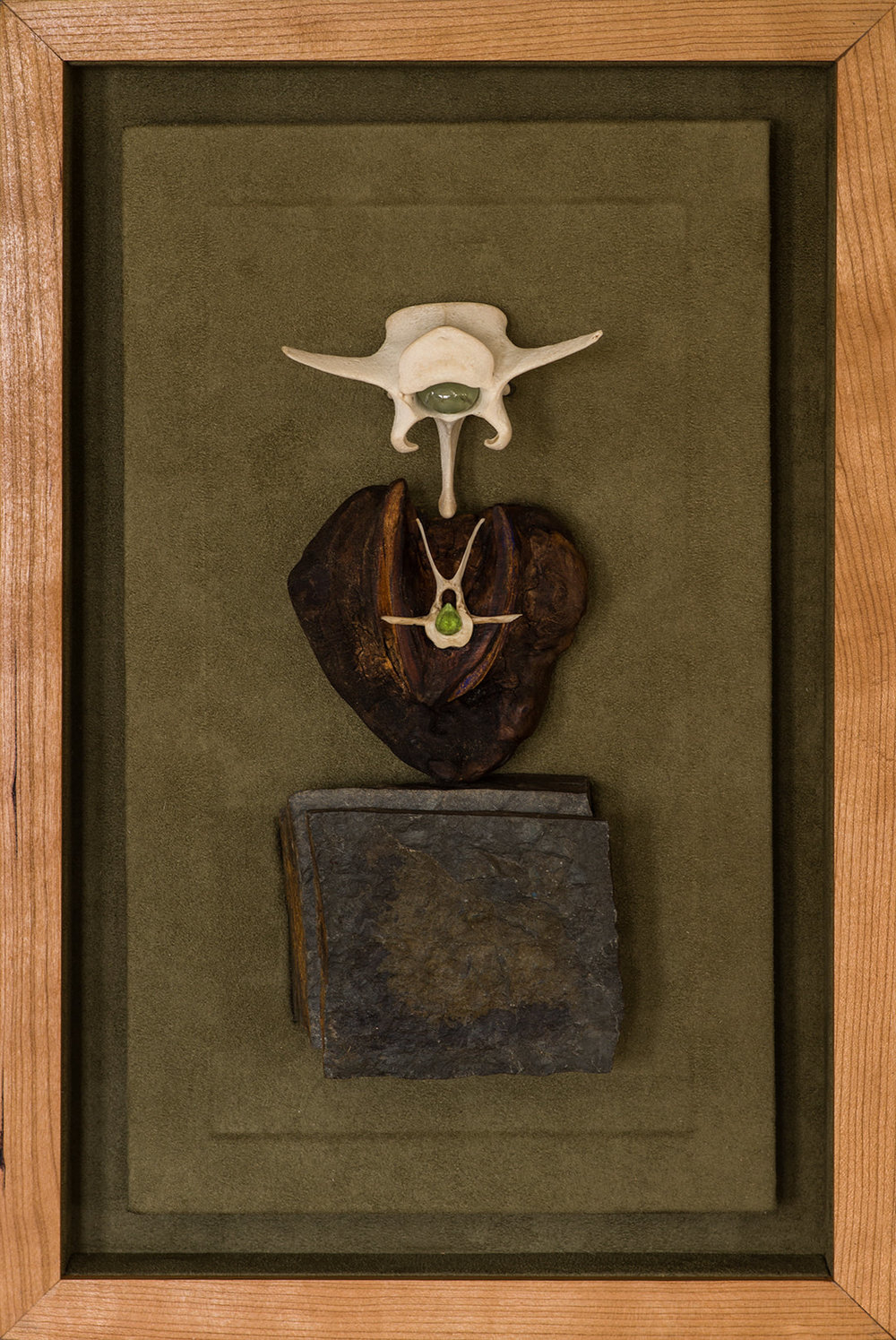 "WOODSTONE BONE   Stone, wood, prehnite, and  Arizona peridot in a lined cherry shadow box     (16 3/4"" x 11"")"