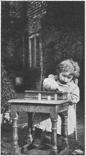 Montessori_child_cylinder_blocks.jpg