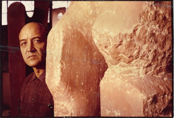 "Isamu Noguchi in his Long Island City studio with ""Red Untitled"" (1965-66), © The Isamu Noguchi Foundation and Garden Museum, New York"