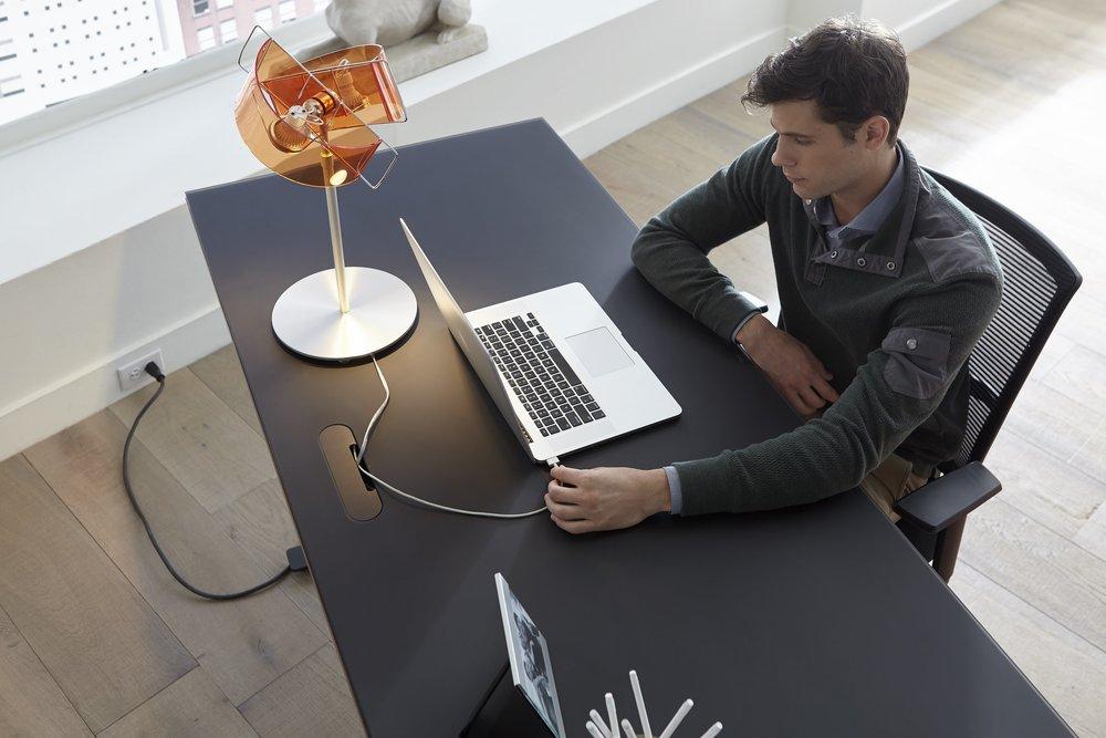 An Adjustable Desk can Improve your workplace ergonomics