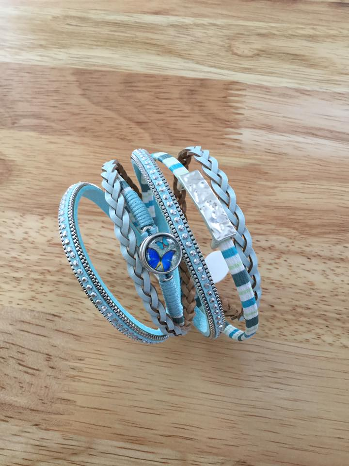 "WRAP BRACELET W/SNAP   $15.00  A sweet butterfly snap enhances the soft turquoise of this double wrap bracelet - a very wearable piece, especially for Spring and Summer.  -Unwrapped, it measures 15.5""  -Secure magnetic closure  -Includes 1 small butterfly snap  -Interchangeable with other small snaps"