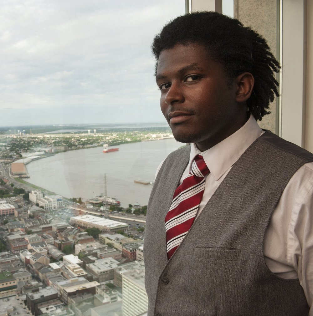 "Kataalyst Alcindor  (Poet):  Kataalyst Alcindor is a New Orleanian poet whose work focuses on the people, culture, and history of his native city. He is a founding member of the spoken word club Slam New Orleans, a three-time National Poetry Slam Champion, and one of the Big Easy's most influential young voices. He was the only poet chosen from thousands of submissions to appear on the second season of Lexus sponsored television show Verse & Flow; a season that earned the show a NAACP Image Award nomination. He recently published a collection of poetry called 'Marrero.' He also performed in on PBS'S ""The Tavis Smiley Show"" in honor of the tenth year commemoration of Hurricane Katrina."