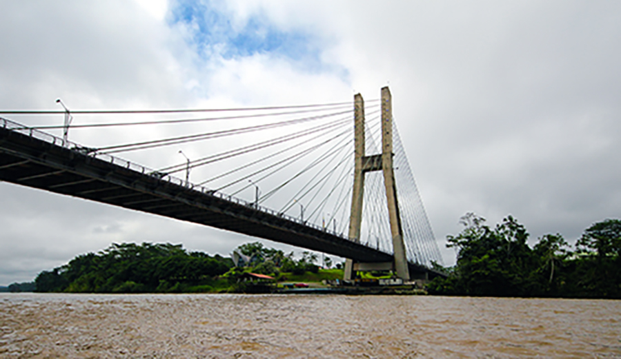 This bridge over the Napo River at Puerto Francisco de Orellana connects the Amazon to the outside world.    (Sierra Bilton)