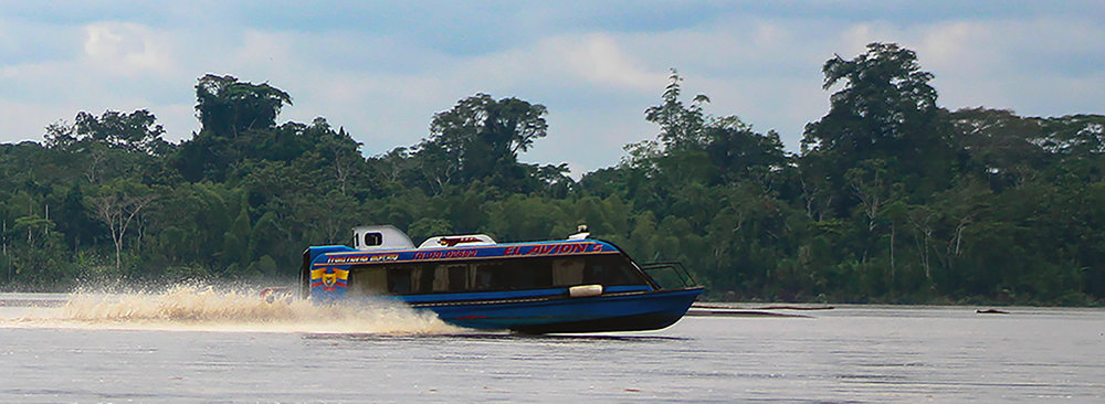 A high-speed motor launch roars up the Napo River, bringing oil workers to the rainforest and, with them, economic opportunity.   (Sierra Bilton)