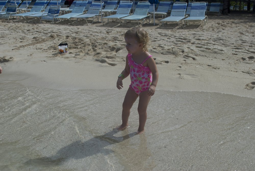 The first time her toes were ever in the ocean water.