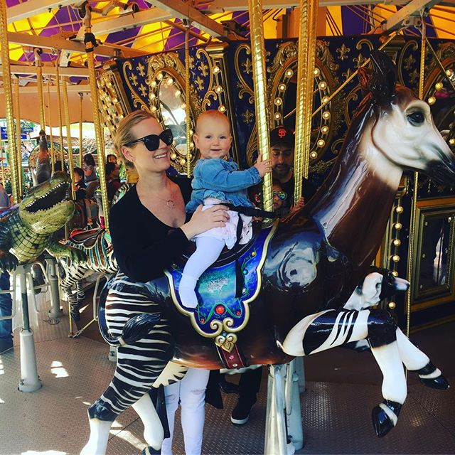 😁 Making smiles happen in and out of the office. Dr. Jennifer taking Ella on her first carousel ride (she's 10 months old now!) 🥰