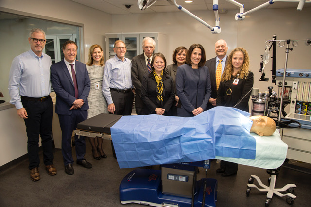 "The Russell Berrie Foundation Board of Trustees pose with mannequin ""Blue Phantom"" during a recent visit to the Institute for Simulation Learning at Holy Name Medical Center. First row, left to right: Angelica Berrie, President, Board of Trustees; Cedar Wang, Director of Simulation Education, HNMC; Ravit Barkama, MD, Assistant Vice President of Clinical Development, HNMC. Second row, left to right: Scott Berrie, Vice President, Board of Trustees; Giora Weisz, MD, Chief of Cardiology, Shaare Zedek Medical Center in Jerusalem; Celeste A. Oranchak, Vice Development of Development, HNMC and Executive Director, HNMC Foundation; Stephen Seiden, Treasurer, Board of Trustees; Myron Rosner, Esq., Secretary, Board of Trustees; Sheryl Slonim, Executive Vice President of Patient Care Services and Chief Nursing Officer, HNMC; Michael Maron, President and Chief Executive Officer, HNMC."