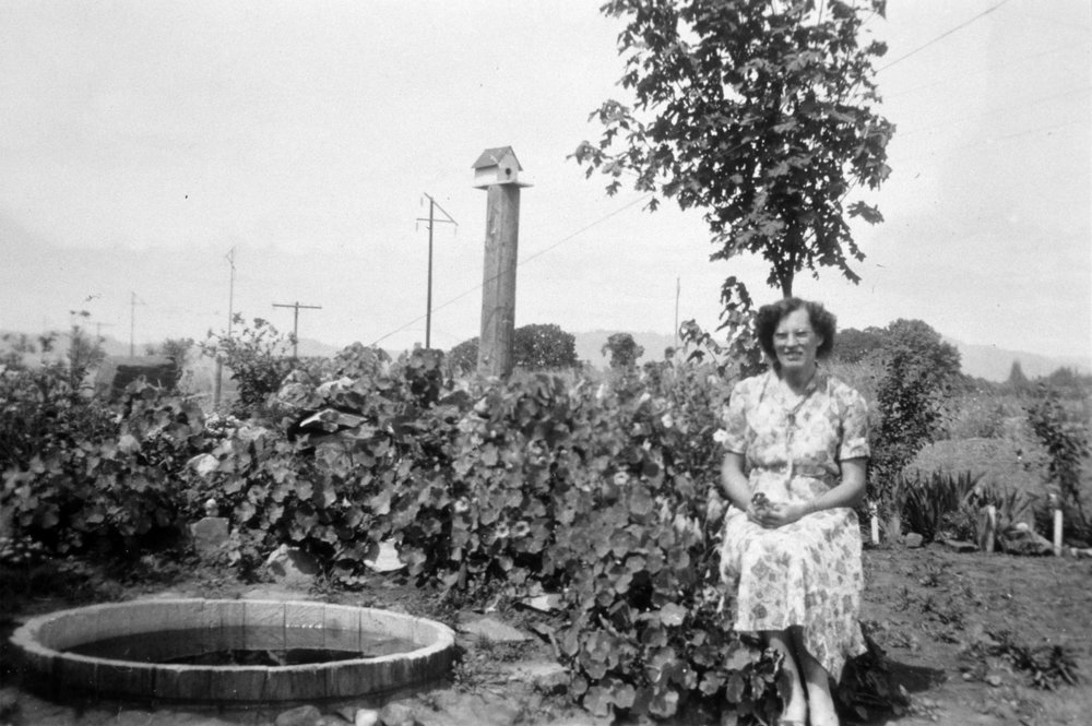 Louise Byer in the garden, years after relocating to the Tualatin Valley.