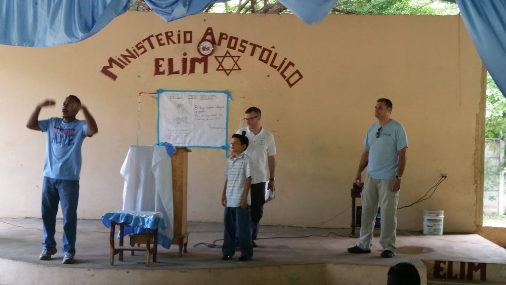 Samuel (our translator), Pastor Ian, a young boy from the local congregation and Dragos re-tell the story of David   and Goliath.