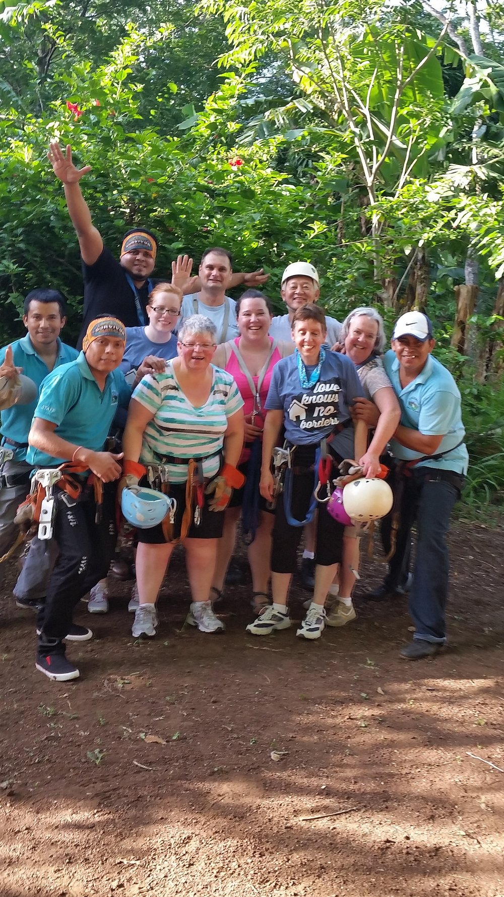 Our team exhilarated after their ziplining experience, pose with their Nicaraguan guides