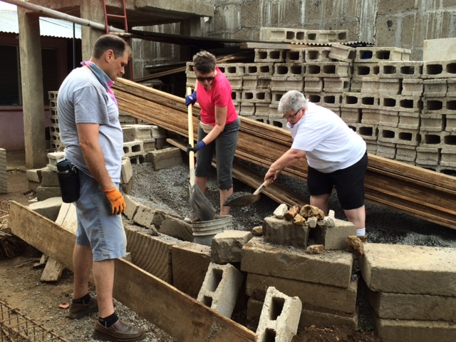 Gwenna and Geraldine mixing cement while Dragos supervises.