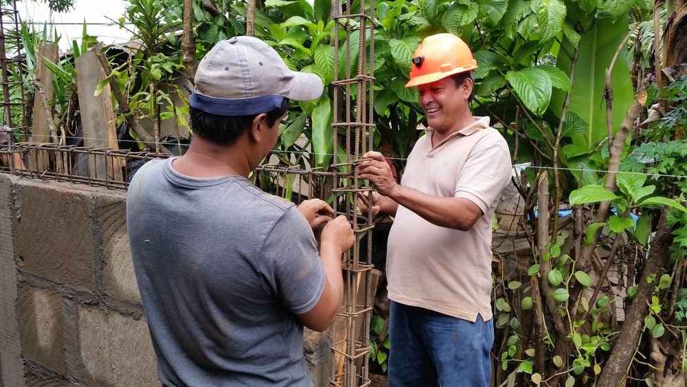 Our Nicaraguan foreman Rolando (right) works on rebar with one of the local workers.