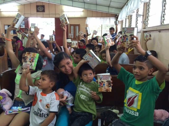 Children waving bibles given to them today.