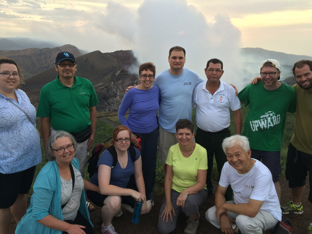Our team celebrates the climb to the top of the Masaya volcano with a new friend, a tourist from Israel (far right). Notice the gas rising from the crater behind us!