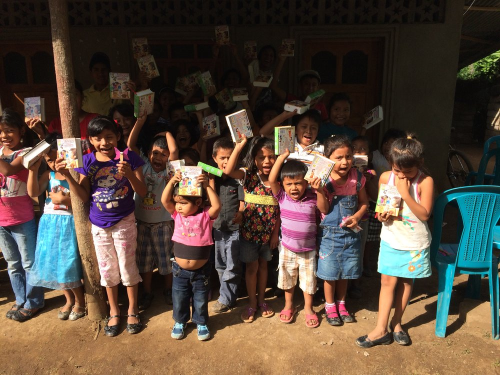 The children proudly display their new Bibles!