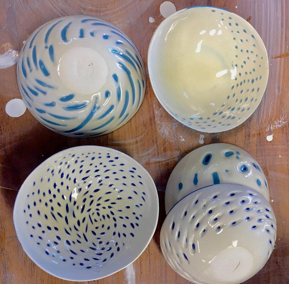 Assorted, carved porcelain bowls